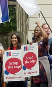 RCN Nurses beginning a summer of protest against pay restraint, protest at Department of Health, London, against the 1 government pay cap for public servants - Stefano Cagnoni - 2010s,2017,activist,activists,against,anti,austerity,Austerity Cuts,BAME,BAMEs,black,BME,bmes,CAMPAIGN,campaigner,campaigners,CAMPAIGNING,CAMPAIGNS,DEMONSTRATING,Demonstration,DEMONSTRATIONS,Departmen