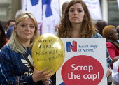 RCN Nurses from Whitechapel Hospital beginning a summer of protest against pay restraint, protest at Department of Health, London, against the government pay cap for public servants - Stefano Cagnoni - 2010s,2017,activist,activists,against,anti,austerity,Austerity Cuts,balloon,balloons,CAMPAIGN,campaigner,campaigners,CAMPAIGNING,CAMPAIGNS,DEMONSTRATING,Demonstration,DEMONSTRATIONS,Department,EARNING