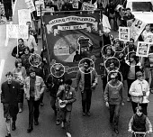 Kent miners march through London on their way to Nottingham to call on miners there to join in a national strike against pit closures. Months after this photograph was taken, 8 of the men at the front... - Stefano Cagnoni - 1980s,1984,activist,activists,against,badge,BADGES,banner,banners,CAMPAIGN,campaigner,campaigners,CAMPAIGNING,CAMPAIGNS,carries,carry,carrying,child,CHILDHOOD,CHILDREN,conviction,DEMONSTRATING,Demonst