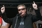Suggs singer with Madness introducing Jeremy Corbyn Not One Day More protest demanding the Tory Government go and an end to austerity policies - Stefano Cagnoni - 2010s,2017,activist,activists,against,anti,austerity,Austerity Cuts,CAMPAIGN,campaigner,campaigners,CAMPAIGNING,CAMPAIGNS,cities,City,demonstrate demonstrating,DEMONSTRATING,Demonstration,DEMONSTRATIO