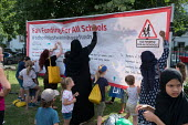Children and parents writing a Fair Funding for All Schools banner Camden NUT rally to oppose cuts to school funding, Kentish Town, London - Philip Wolmuth - 04-07-2017