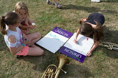 Stop the Cuts. Children making Unison placards, Camden NUT rally against cuts to school funding, Kentish Town, London - Philip Wolmuth - 04-07-2017