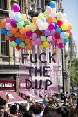 Fuck the DUP placard, Pride in London, Love Happens Here, Trafalgar Square, London. - Jess Hurd - unionist, unionists,2010s,2017,ACE,balloon,balloons,Culture,DUP,equal,Gay,Gay Pride,Gays,Homosexual,HOMOSEXUALITY,Homosexuals,lesbian,LESBIANS,LGBT,London,Love Happens Here,MINORITIES,MINORITY,parade,