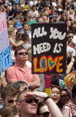 Pride 2017. Gay Pride celebration and march London. All you need is love - Stefano Cagnoni - 2010s,2017,ACE,CELEBRATE,celebrating,celebration,CELEBRATIONS,COLOR,colors,colour,colours,Culture,equal,FEMALE,Gay,Gay Pride,gays,homosexual,homosexuality,Homosexuals,Lesbian,lesbians,LGBT,Love Happen