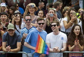Pride 2017. Happy crowd watching Gay Pride celebration and march London - Stefano Cagnoni - 2010s,2017,ACE,CAMERA,camera phone,cameras,CELEBRATE,celebrating,celebration,CELEBRATIONS,COLOR,colors,colour,colours,crowd,Culture,EMOTION,EMOTIONS,equal,equality,FEMALE,Gay,Gay Pride,gays,HAPPINESS,