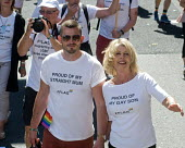 Pride 2017. Straight Mum with her Gay son at Gay Pride celebration and march London - Stefano Cagnoni - 2010s,2017,ACE,adult,adults,CELEBRATE,celebrating,celebration,CELEBRATIONS,COLOR,colors,colour,colours,Culture,equal,equality,FAMILY,FEMALE,Gay,Gay Pride,gays,heterosexual,homosexual,homosexuality,Hom