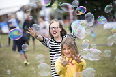 Kids area, Tolpuddle Martyrs Festival, Dorset. - Jess Hurd - 2010s,2017,ACE,bubble,bubbles,child,CHILDHOOD,children,Dorset,female,females,Festival,festivals,girl,girls,having fun,juvenile,juveniles,kid,kids,LFL,LIFE,member,member members,members,people,play,pla