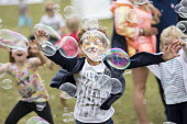 Kids area, Tolpuddle Martyrs Festival, Dorset. - Jess Hurd - 2010s,2017,ACE,boy,boys,bubble,bubbles,child,CHILDHOOD,children,Dorset,female,females,Festival,festivals,girl,girls,having fun,juvenile,juveniles,kid,kids,LFL,LIFE,male,member,member members,members,p