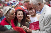 Jeremy Corbyn signing copies of the Labour manifesto, Tolpuddle Martyrs Festival, Dorset - Jess Hurd - 16-07-2017
