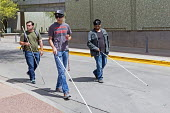 Phoenix, Arizona, USA. Blind and visually impaired young men, some wearing sleep masks, practice navigating city streets with a white cane - Jim West - 07-04-2017