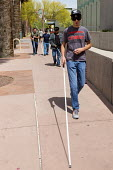 Phoenix, Arizona, USA. Blind and visually impaired young men, some wearing sleep masks, practice navigating city streets with a white cane - Jim West - 2010s,2017,America,Arizona,blind,blindfold,blindfolded,cane,cities,City,disabilities,disability,disable,disabled,disablement,incapacity,minorities,mobility,navigating,needs,pedestrian,pedestrians,peop