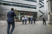 Bankers return to work at UBS Bank after their lunch break. Broadgate Circle, part of a privately owned and managed public space around Liverpool Street station, London - Philip Wolmuth - 28-07-2017