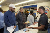 "Detroit, Michigan USA Job seekers at a UAW union hall job fair ""Expungements, Pardons and Jobs. Companies billed as ""ex-felon friendly"" attending. Ex prisoners find it difficult to find work because o... - Jim West - African Americans,2010s,2017,AFL CIO,AFL-CIO,African American,America,american,americans,application,applying,BAME,BAMEs,black,BME,bmes,busy,cities,City,CLJ,communicating,communication,companies,compa"