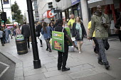 Worker wearing a Sandwich board handing out leaflets promoting Subway sandwich shop, Oxford Street, London - Jess Hurd - 2010s,2017,advertisement,advertisements,advertising,BAME,BAMEs,Black,BME,BME Black Minority Ethnic,bmes,cities,City,communicating,communication,diversity,EARNINGS,employee,employees,Employment,ethnic,