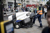 Veolia environmental services road sweeper, Oxford Street, London. - Jess Hurd - 2010s,2017,cities,City,clean,cleaner,cleaners,cleaning,cleansing,Council Services,Council Services,employee,employees,Employment,ENVIRONMENT,environmental,highway,job,jobs,LBR,local authority,London,m