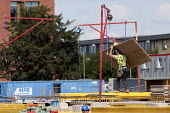 Construction workers with hangman overhead anchor device on a building site, Stratford upon Avon, Warwickshire - John Harris - 10-08-2017