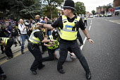 Police making an arrest. Anti fascist protestors confronting National Front march, Grantham, Lincolnshire - Jess Hurd - 19-08-2017