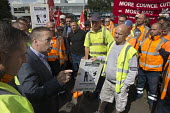 Howard Beckett Unite speaking to members. Birmingham council refuse workers go on strike against redundancies, Perry Barr Depot, Birmingham. Birmingham City Council want to save 600,000 a year by axin... - John Harris - 01-09-2017