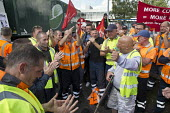 Birmingham council refuse workers go on strike against redundancies, Perry Barr Depot, Birmingham. Birmingham City Council want to save 600,000 a year by axing 113 grade three bin men and replacing th... - John Harris - 2010s,2017,against,Austerity Cuts,bin man,bin man binmen,bin men,binman,binmen,Birmingham,cities,City,collection,collector,council,Council Services,council service,Council Services,Council Workers,dis