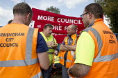 Birmingham council refuse workers go on strike against redundancies, Perry Barr Depot, Birmingham. Birmingham City Council want to save 600,000 a year by axing 113 grade three bin men and replacing th... - John Harris - 2010s,2017,against,Austerity Cuts,banner,banners,bin man,bin man binmen,bin men,binman,binmen,Birmingham,cities,City,collection,collector,communicating,communication,conversation,conversations,council