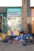 Homeless young man begging and pet dog on the pavement outside Poundland, Stratford upon Avon, Warwickshire - John Harris - 2010s,2017,animal,animals,beg,beggar,beggars,BEGGER,begging,begs,canine,dog,dogs,excluded,exclusion,HARDSHIP,homeless,homelessness,impoverished,impoverishment,INEQUALITY,male,man,Marginalised,men,outs