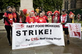 McDonalds workers strike rally, Westminster, London. Fast Food Rights Campaign want 10 pounds an hour, end to zero hour contracts and union rights - Jess Hurd - 2010s,2017,activist,activists,against,banner,banners,BFAWU,CAMPAIGN,campaigner,campaigners,CAMPAIGNING,CAMPAIGNS,cities,City,contract,contracts,costume,costumes,DEMONSTRATING,Demonstration,DEMONSTRATI