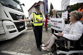 Celia Davies, veteran Quaker peace campaigner who had her neck broken by the police at Greenham Common. Stop DSEi arms fair protest prevents vehicle entering ExCel centre London Stop Arming Israel. De... - Jess Hurd - 04-09-2017