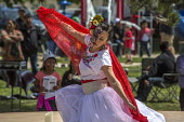 Greenfield, California, USA Migrants from Oaxaca dancing at a festival of Oaxacan culture in the Salinas Valley where many Triquis have settled - David Bacon - 2010s,2017,ACE,american,americans,amerindian,amerindians,Arts,BAME,BAMEs,BME,bmes,California,costume,Culture,dance,dancer,dancers,dancing,Diaspora,diversity,ethnic,ethnic.POC,ethnicity,FEMALE,festival