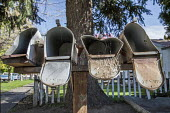 Yakima, Washington, USA Mailboxes in a neighborhood of migrant Mexican workers. Mainly farm workers and packing shed workers, North 6th Street - David Bacon - 2010s,2017,american,americans,amerindian,amerindians,BAME,BAMEs,BME,bmes,box,boxes,casual workers,Diaspora,disused,diversity,EBF,Economic,Economy,ethnic,ethnic.POC,ethnicity,farm,farm worker,farm work