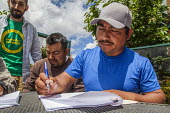 Burlington, Washington, USA Members of Familias Unidas por la Justicia signing a contract negotiated with Sakuma Brothers Farms, with Danny Weeden, general manager of the company, after four years of... - David Bacon - 16-06-2017