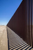 Imperial Valley, California, USA US Mexican border wall - David Bacon - 2010s,2017,american,americans,BAME,BAMEs,BME,bmes,border,border control,border controls,Border Patrol,borders,California,CLJ,Colorado Desert,country,countryside,desert,Diaspora,diversity,ethnic,ethnic