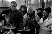 Liverpool dockers cooking breakfast in the early morning during the two and a half year long dock dispute during which 400 dockers were sacked for refusing to cross a picket line, during which time th... - David Sinclair - 12-01-1997