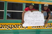 Tijuana, Mexico, Farmworkers in AONEMJS on strike for better conditions and pay. From the San Quintin Valley in Baja California they take buses to Tijuana, to march to the U.S.A Mexico border, to draw... - David Bacon - 2010s,2015,activist,activists,ananabpotprotest,ananabpottu,AONEMJS,border,BUS,bus buses,bus service,buses,California,CAMPAIGN,campaigner,campaigners,CAMPAIGNING,CAMPAIGNS,defiant,DEMONSTRATING,demonst