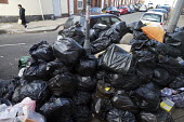 Rubbish piling up, Sparkbrook, Birmingham Bin workers strike - John Harris - 2010s,2017,bag,bags,bin,bin bag,bin bags,binbag,binbags,bins,Birmingham,Black,cities,City,disputes,heap,industrial dispute,litter,male,man,member,member members,members,men,pavement,pedestrian,pedestr