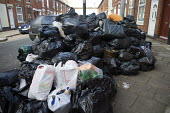 Rubbish piling up, Sparkbrook, Birmingham Bin workers strike - John Harris - 2010s,2017,bag,bags,bin,bin bag,bin bags,binbag,binbags,bins,Birmingham,Black,cities,City,disputes,heap,industrial dispute,litter,member,member members,members,pavement,people,pile,piled up,Plastic,RE