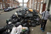 Rubbish piling up, Sparkbrook, Birmingham Bin workers strike - John Harris - 2010s,2017,Asian,Asians,bag,bags,BAME,BAMEs,bin,bin bag,bin bags,binbag,binbags,bins,Birmingham,Black,BME,bmes,cities,City,disputes,diversity,ethnic,ethnicity,heap,industrial dispute,litter,male,man,m
