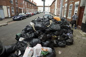 Rubbish piling up, Sparkbrook, Birmingham Bin workers strike - John Harris - 2010s,2017,bag,bags,bin,bin bag,bin bags,binbag,binbags,bins,Birmingham,Black,cities,City,disputes,heap,industrial dispute,litter,male,man,member,member members,members,men,pavement,people,person,pers