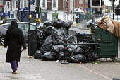 Rubbish piling up, Sparkbrook, Birmingham Bin workers strike - John Harris - 2010s,2017,Asian,Asians,bag,bags,BAME,BAMEs,bin,bin bag,bin bags,binbag,binbags,bins,Birmingham,Black,BME,bmes,cities,City,disputes,diversity,ethnic,ethnicity,FEMALE,heap,industrial dispute,litter,mem