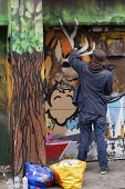 Graffiti artist spray painting a mural, Brighton - John Harris - 25-09-2017