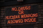 No Drugs or Nuclear Weapons Allowed Inside neon sign outside a bar, Brighton - John Harris - 2010s,2017,atomic,bar,bars,cannabis,communicating,communication,drug,drugs,funny,humor,humorous,HUMOUR,joking,Leisure,LFL,LICENSED,LIFE,Lifestyle,light,neon lights,Night Out,nightclub,NIGHTCLUBS,night