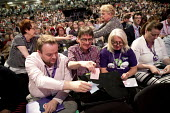 UNISON deleagtes voting in a card vote, Labour Party Conference, Brighton 2017 - Jess Hurd - 2010s,2017,ballot,Ballot Box,Ballot Box boxes,BALLOTING,ballots,Brighton,Conference,conferences,deleagtes,delegate,delegates,delegation,democracy,FEMALE,Labour Party Conference,member,member members,m