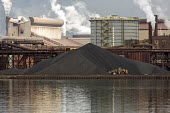 Sault Ste. Marie, Ontario Canada - A pile of coal at the Algoma steel mill on the shore of the St. Marys River. - Jim West - 2010s,2017,air pollution,Algoma,Algoma Steel,C02 Emissions,Canada,capitalism,chimney,chimneys,Climate Change,coal,coke,dock,docks,dockside,EBF,Economic,Economy,emissions,ENI,environment,Environmental
