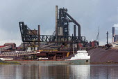 Sault Ste. Marie, Ontario Canada - The Michipicoten, a bulk cargo carrier, docked at the Algoma steel mill on the shore of the St. Marys River. - Jim West - 05-09-2017