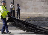 London Police Officers laying out a Talon spiked net outside Parliament to prevent vehicle terror attacks against crowds attending major events. The nets are capable of stopping lorries weighing up to... - Stefano Cagnoni - 2010s,2017,adult,adults,against,Anti Terrorist Unit,attack,attacking,attacks,boots,cities,City,CLJ,crime prevention,deploy,deploying,deployment,device,devices,equipment,force,HAULAGE,HAULIER,HAULIERS,
