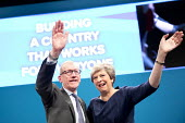 Theresa and Philip May waving, Conservative Party Conference, Manchester 2017 - Jess Hurd - 2010s,2017,Conference,conferences,CONSERVATIVE,Conservative Party,Conservative Party Conference,conservatives,FEMALE,Manchester,MP,MPs,Party,people,person,persons,POL,political,politician,politicians,