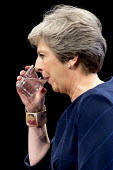 Theresa May with Frida Kahlo bracelet speaking Conservative Party Conference, Manchester 2017 Revolutionary artist Frida Kahlo de Rivera was a feminist, member of the Mexican Communist Party and alleg... - Jess Hurd - 2010s,2017,artist,ARTISTS,Conference,conferences,CONSERVATIVE,Conservative Party,Conservative Party Conference,conservatives,FEMINISM,feminist,FEMINISTS,Frida Kahlo,Manchester,Mexican,MP,MPs,Party,POL