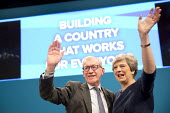 Theresa and Philip May waving, Conservative Party Conference, Manchester 2017 - Jess Hurd - 2010s,2017,Conference,conferences,CONSERVATIVE,Conservative Party,Conservative Party Conference,conservatives,Manchester,MP,MPs,Party,POL,political,politician,politicians,Politics,Theresa May,waving