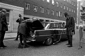 Police using mirror to look under and detect car bombs during IRA bombing campaign, London 1975 - NLA - 1970s,1975,adult,adults,AUTO,AUTOMOBILE,AUTOMOBILES,AUTOMOTIVE,bomb,bombing,bombings,bombs,car,car bombs,cars,catholic,catholics,cities,City,CLJ,Conflict,Conflicts,destroyed,destruction,detect,detecti