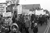 Community protest at the rent increase for council house tenants, Merthyr Tydfil, South Wales, 1973 - NLA - 1970s,1973,activist,activists,adult,adults,banner,banners,CAMPAIGNING,CAMPAIGNS,child,CHILDHOOD,children,communities,Community,council,Council Housing,Council Housing,council tenants,DEMONSTRATING,Dem