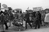 Protest on Canvey Island against Occidental oil refineries and pollution, with an oil tanker behind the protestors, 1973 - NLA - 1970s,1973,activist,activists,against,CAMPAIGNING,CAMPAIGNS,Canvey Island,capitalism,capitalist,child,CHILDHOOD,children,communities,community,Community Action Group,DEMONSTRATING,Demonstration,enviro